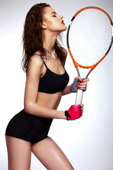 sexy brunette young professional tennis player model with racket