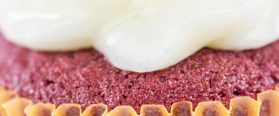 Texture of a red velvet cupcake with sugar glazing