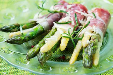 Fresh young asparagus wrapped in Prosciutto ham