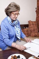 Senior Businesswoman about to Write