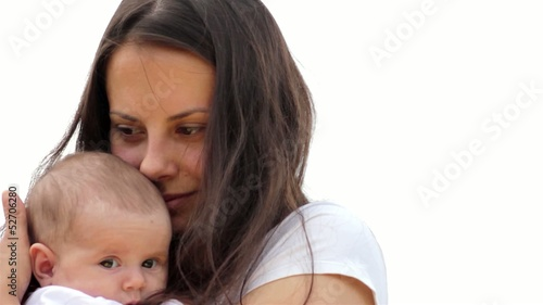 Close up of a young mother holding her baby.