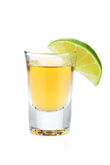 Shot of gold tequila with lime slice