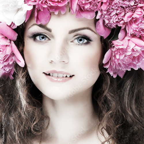beautiful young girl with pink flowers