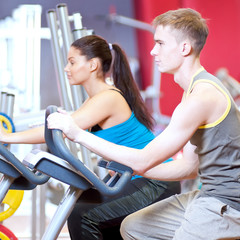 People in the gym doing cardio cycling training