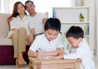 Asian boy writing