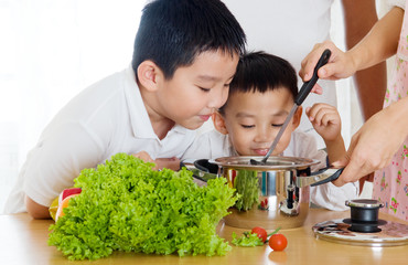 asian boys smell their mother's cooking