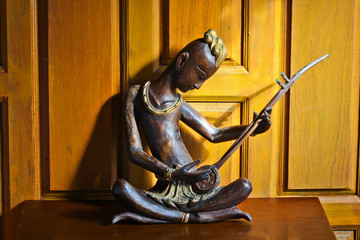 Wood carvings. Thailand is the people who playing the instrument