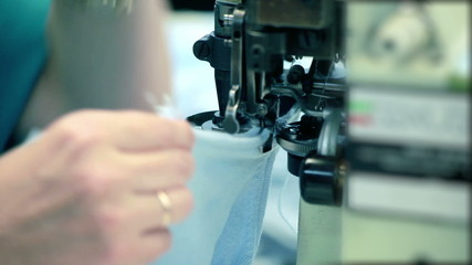 Working at Industrial sewing machine