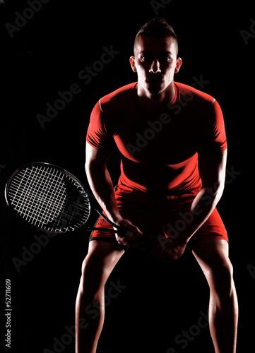 Fototapeta Tenista sujetando una raqueta de tenis.