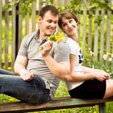 The guy grants to the girl flowers