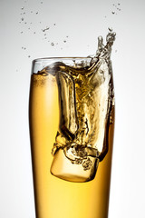 Beer splash with ice