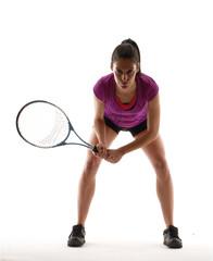 Mujer tenista jugando tenis.
