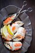 Boiled crab claws on plate, selective focus
