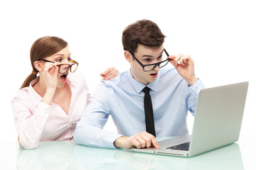 Shocked couple in front of laptop