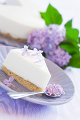 Yogurt cream cake with lilac, selective focus