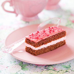 Piece of chocolate raspberry cake, selective focus