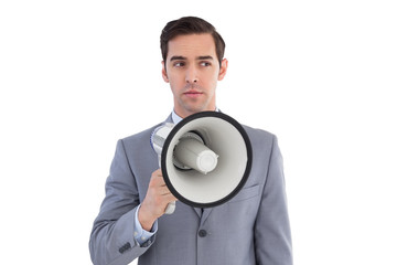 Business preparing himself to shout with a megaphone