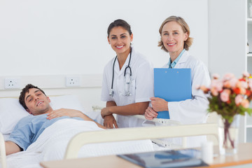 Two doctors and a patient looking at the camera