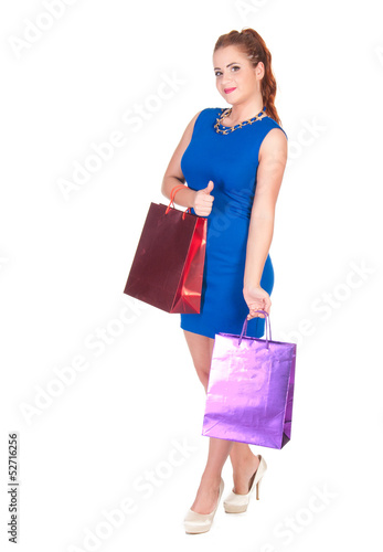 Young woman in blue dress with shopping bags