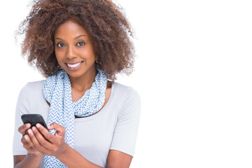 Cheerful woman typing a text message