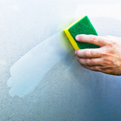 Cleaning car using a cleaning sponge
