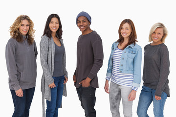 Fashionable young people in a line smiling