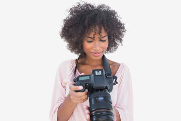 Happy woman looking at digital camera