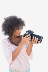 Smiling woman looking through digital camera