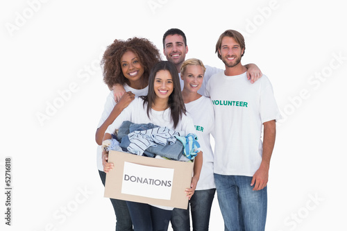 Smiling group of volunteers holding donation box
