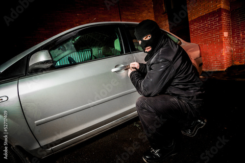 Car thief in a mask.