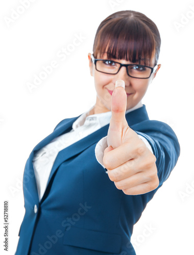 Positive businesswoman with thumb up showing success