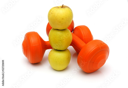 concept of healthy life with apples and weights