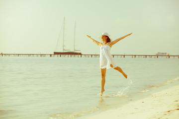 Caucasian woman dancing at the sea