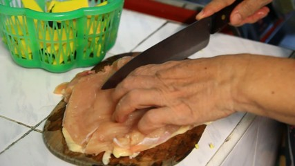 cooking, cutting chicken meat