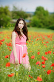 brunette in poppy field