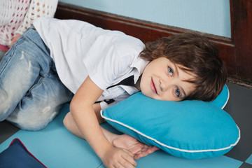 Boy Lying On Heartshaped Pillow In