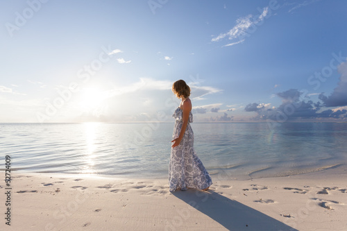Caucasian woman walks along beautiful seashore