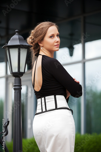 Sad beautiful woman at lamppost