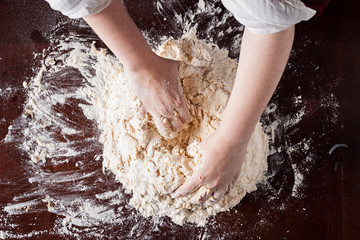 Hands preparing pizza dough