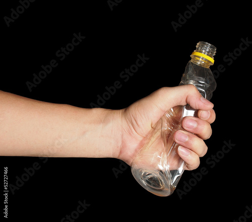 Hand grab plastic bottle on black background