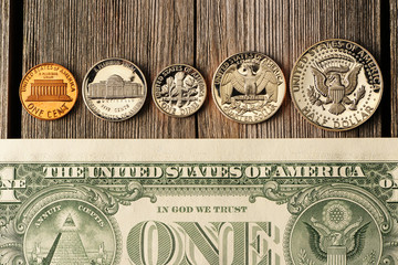 US money over wooden background