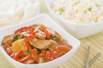 Chinese style pork with red peppers served with egg fried rice.