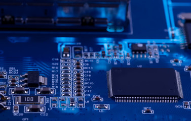 macro photo of electronic circuit. PCB on the lighting.