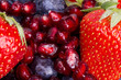 Ripe pomegranate, blueberrie, strawberry background