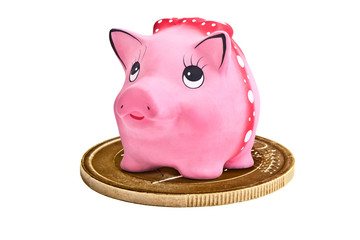 Piggy ceramics moneybox on euro coin