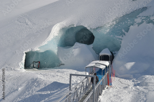 Entrance to ice cave under glacier in Chamonix