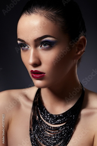 beautiful model with bright makeup with accessories in studio