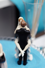 Figurines on top of wedding cake
