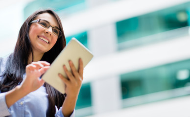 Business woman with a tablet computer