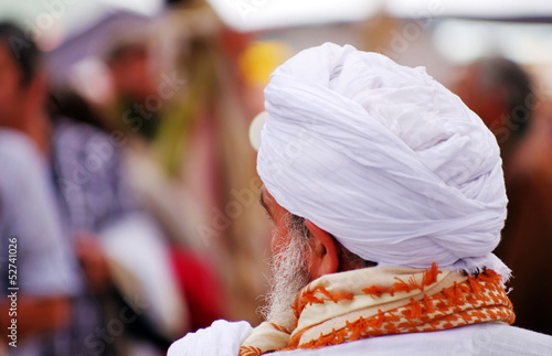 Arabic  man with turban at islamic Fair